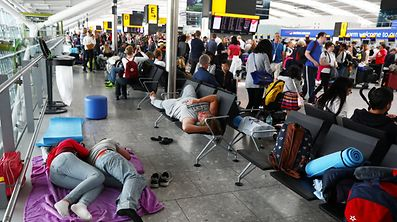 People sleep next to their luggage at Heathrow Terminal 5 in London, Britain May 28, 2017. REUTERS/Neil Hall