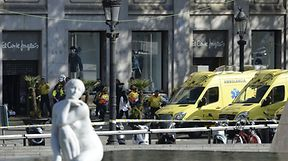 """A person is stretched out of a mall by medical staff members in a cordoned off area after a van ploughed into the crowd, injuring several persons on the Rambla in Barcelona on August 17, 2017. Police in Barcelona said they were dealing with a """"terrorist attack"""" after a vehicle ploughed into a crowd of pedestrians on the city's famous Las Ramblas boulevard on August 17, 2017. Police were clearing the area after the incident, which has left a number of people injured. / AFP PHOTO / Josep LAGO"""
