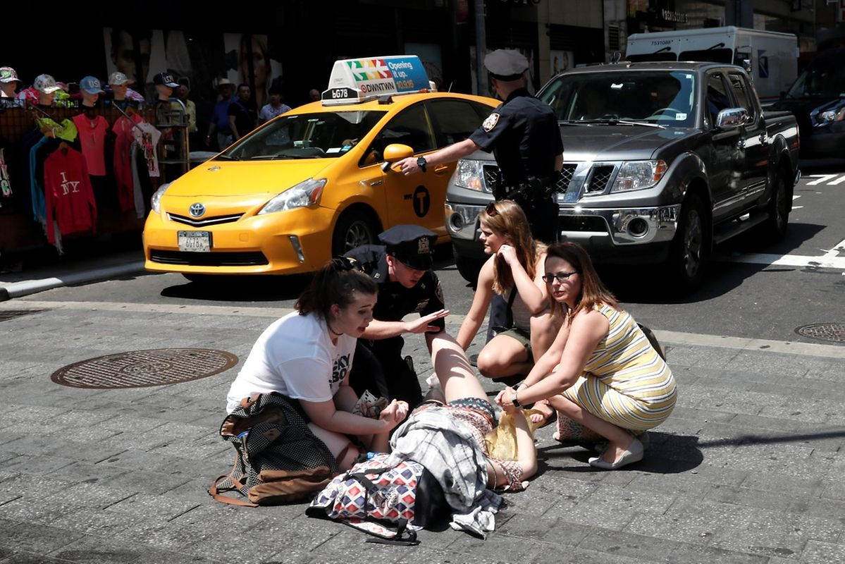 ATTENTION EDITORS - VISUALS COVERAGE OF SCENES OF DEATH OR INJURY An injured woman is seen at a crosswalk in Times Square after a speeding vehicle struck pedestrians on the sidewalk in New York City, U.S., May 18, 2017. REUTERS/Mike Segar. TEMPLATE OUT