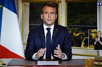 This screen shot made on April 16, 2019 shows French President Emmanuel Macron addressing the nation on French private TV channel TF1 during which he vows to rebuild Notre-Dame de Paris Cathedral within five years, a day after a fire erupted in the 850-year-old landmark, and Macron had cancelled a speech expected to outline key measures in response to months of anti-governments protests. (Photo by Olivier MORIN / AFP)