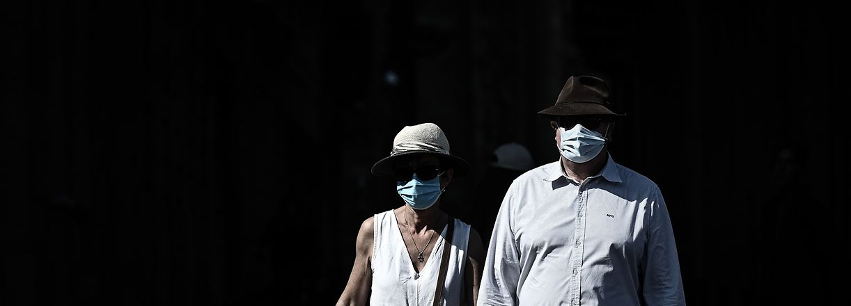 Pedestrians wearing protective face masks due to the COVID-19 disease caused by the novel coronavirus, walk in a street of Bordeaux, southwestern France, on September 14, 2020. (Photo by Philippe LOPEZ / AFP)