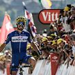 France's Julian Alaphilippe celebrates as he crosses the finish line to win the tenth stage of the 105th edition of the Tour de France cycling race between Annecy and Le Grand-Bornand, French Alps, on July 17, 2018. / AFP PHOTO / Philippe LOPEZ