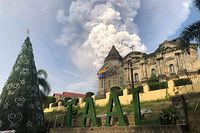 "This handout photo taken and received on January 12, 2020 courtesy of Renz Lejarso Guevara shows ash from the Taal volcano (not pictured) in the air, as seen against a church in the foreground in the town of Taal in Batangas province south of Manila. - A volcano near the Philippine capital Manila spewed a massive cloud of ash into the sky on January 12, forcing the precautionary evacuation of thousands of residents, authorities said. (Photo by Handout / Courtesy of Renz Lejarso Guevara / AFP) / RESTRICTED TO EDITORIAL USE - MANDATORY CREDIT ""AFP PHOTO / Courtesy of Renz Lejarso Guevara"" - NO MARKETING NO ADVERTISING CAMPAIGNS - DISTRIBUTED AS A SERVICE TO CLIENTS --- NO ARCHIVE ---"