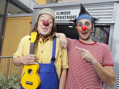 Clowns outside a paediatric clinic