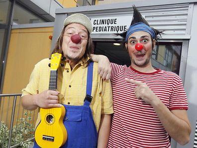 Clowns outside a paediatric clinic