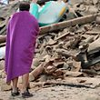 A man stands among the rubble of a house after a strong heartquake hit Amatrice
