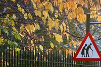 "A sign warns motorists to be aware of elderly people crossing a road in London, in this November 29, 2005 file picture. The pensions industry and the government says younger generations are setting themselves up for a retirement spent in poverty, a contrast to those retiring now flush from final salary pension schemes and the proceeds of a housing boom. Official figures show less than half of all UK employees were saving into a workplace pension scheme in 2011, with young people seen among the most reluctant savers. ""This is storing up massive socio-economic problems for the future,"" said Malcolm McLean, a consultant at Barnett Waddingham, one of Britain's largest independent firms of actuaries, administrators and consultants. He and others predict years of ""inter-generational strife"": a cycle of parents who come to rely on their offspring to provide for them in retirement, hurting that generation's capacity to save for their old age, and so forcing the next generation of children to support them in turn. Picture taken November 29, 2005.  To match Insight BRITAIN-PENSIONS      REUTERS/Toby Melville/Files (BRITAIN  - Tags: BUSINESS HEALTH SOCIETY)"