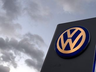 The logo of German carmaker Volkswagen at a VW dealership in Hamburg, in this October 28, 2013 file photo. Germany's Volkswagen on July 31, 2014 said operating profit declined 3.1 percent in the second quarter as emerging-market volatility and the carmaker's weakening U.S. business weighed on earnings. REUTERS/Fabian Bimmer/Files (GERMANY - Tags: TRANSPORT BUSINESS LOGO)