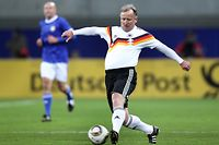 LEIPZIG, GERMANY - NOVEMBER 20:  Andreas Brehme of the World Champion 1990 runs with the ball during the Reunification match between the World Champion 1990 and the DFV Legend at the Red Bull Arena on November 20, 2010 in Leipzig, Germany.  (Photo by Ronny Hartmann/Bongarts/Getty Images)