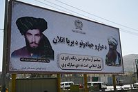 Commuters drive past a billboard with the images of late Afghan Taliban leader Mullah Omar (L) and late Afghan leader of the Haqqani network Jalaluddin Haqqani displayed on a billboard along a roadside in Kabul on September 9, 2021. (Photo by Aamir QURESHI / AFP)