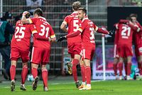 (L to R) Union Berlin's German defender Christopher Lenz, Union Berlin's German defender Robin Knoche, Union Berlin's German defender Marvin Friedrich and Union Berlin's Danish forward Marcus Ingvartsen celebrate during the German first division Bundesliga football match between 1 FC Union Berlin and Bayer Leverkusen in Berlin, on January 15, 2021. (Photo by Andreas Gora / POOL / AFP) / DFL REGULATIONS PROHIBIT ANY USE OF PHOTOGRAPHS AS IMAGE SEQUENCES AND/OR QUASI-VIDEO
