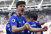 (FILES) In this file photo taken on April 20, 2019 Leicester City's English defender Harry Maguire celebrates during the English Premier League football match between West Ham United and Leicester City at The London Stadium, in east London on April 20, 2019. - Harry Maguire became the world's most expensive defender on August 5, 2019 when Manchester United signed him for a reported fee of �80 million ($97 million). (Photo by Ben STANSALL / AFP) / RESTRICTED TO EDITORIAL USE. No use with unauthorized audio, video, data, fixture lists, club/league logos or 'live' services. Online in-match use limited to 120 images. An additional 40 images may be used in extra time. No video emulation. Social media in-match use limited to 120 images. An additional 40 images may be used in extra time. No use in betting publications, games or single club/league/player publications. /