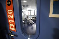 TOPSHOT - A patient is hospitalised at a level intensive care unit for patients infected with Covid-19 (novel coronavirus) at the University Hospital of Strasbourg (HUS) in Strasbourg, eastern France on October 22, 2020. (Photo by FREDERICK FLORIN / AFP)