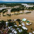 TOPSHOT - A general view of the flooded Municipality of Kabacan, North Cotabato, on the southern island of Mindanao on December 23, 2017, after Tropical Storm Tembin dumped torrential rains across the island. The death toll from a tropical storm in the southern Philippines climbed swiftly to 133 on December 23, as rescuers pulled dozens of bodies from a swollen river, police said. / AFP PHOTO / FERDINANDH CABRERA
