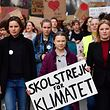 Swedish 16-years-old climate activist Greta Thunberg (C) takes part in a march for the environment and the climate organised by students, in Brussels, on Februaru 21, 2019. - Greta Thunberg, the 16-year-old Swedish climate activist who has inspired pupils worldwide to boycott classes, urged the European Union on February 21, 2019 to double its ambition for greenhouse gas cuts. (Photo by EMMANUEL DUNAND / AFP)