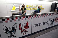 Members of Australia's Olympic softball team, the first national team to come to Japan for pre-Olympic training camp since the Tokyo 2020 Olympic Games were postponed to 2021 due to COVID-19, arrive at Narita international airport in Narita, east of Tokyo, on June 1, 2021. (Photo by ISSEI KATO / POOL / AFP)