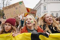 Young protesters hold placards during a demonstration of the Fridays for Future movement for climate protection in Warsaw, on November 29, 2019. (Photo by JANEK SKARZYNSKI / AFP)