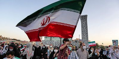 Supporters of Iran's newly-elected president Ebrahim Raisi celebrate his victory in the capital Tehran on Sunday