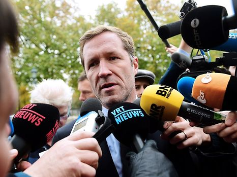 Minister-President of Belgium's French-speaking Walloon Region Paul Magnette answers journalists as he arrives for an emergency meeting of all Belgium federal entities on the EU-Canada Comprehensive Economic and Trade Agreement (CETA) in Brussels on October 24, 2016.