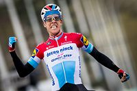 Luxembourg's  Bob Jungels of Deceuninck - Quick-Step celebrates as he crosses the finish line to win the 71st edition of the Kuurne-Brussels-Kuurne one day cycling race, 200,1 km from Kuurne to Kuurne via Brussels on March 3, 2019, in Kuurne. (Photo by JASPER JACOBS / Belga / AFP) / Belgium OUT