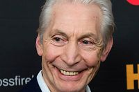 """(FILES) In this file photo taken on November 13, 2012 Charlie Watts of the Rolling Stones arrives at the Ziegfeld Theater to view """"Crossfire Hurricane"""" in New York. - Charlie Watts, drummer with legendary British rock'n'roll band the Rolling Stones, died on August 24, 2021 aged 80, according to a statement from his publicist. (Photo by Don EMMERT / AFP)"""
