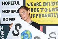 MILAN, ITALY - JUNE 14: Stella McCartney poses with a sign readin 'SOS' during the presentation of Stella McCartney during the Milan Men's Fashion Week Spring/Summer 2020 on June 14, 2019 in Milan, Italy. (Photo by Daniele Venturelli/Getty Images)