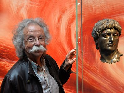 Science journalist and television host Jean Puetz stands in front of the bronze bust of Nero, on loan from the Louvre in Paris, in the Landesmuseum in�Trier, Germany, 15 May 2016. The exhibition with around 700 items in three museum in Trier can be seen from 14 May until 16 October 2016. Photo:�HARALD�TITTEL/dpa