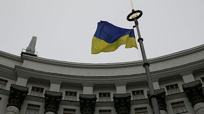 A Ukrainian national flag flies in front of the Government building in central Kiev.