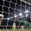 Arsenal's German-born Bosnian defender Sead Kolasinac (3rd R) watches his shot hit the back of the Cologne net to make the score 1-1 during the UEFA Europa League Group H football match between Arsenal and FC Cologne at The Emirates Stadium in London on September 14, 2017. Arsenal won the game 3-1. / AFP PHOTO / Adrian DENNIS