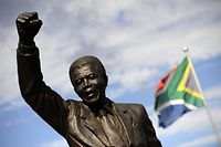 A bronze statue depicting former South African president Nelson Mandela as he walked to freedom in 1990 following his release after 27 years of incarceration, stands on February 10, 2010, outside the Groot Drakenstein prison in Paarl, about 90Kms from Cape Town on the eve of the 20th Anniversary of his liberation. Mandela was kept in a private house at the Groot Drakenstein prison after being released from Robben Island prison in 1988, where he remained until his release by the apartheid government on February 11 1990.