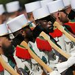 Pioneers of the 1st Foreign Legion regiment carry their axes as they march during the traditional Bastille Day military parade on the Champs-Elysees in Paris, France, July 14, 2017. REUTERS/Stephane Mahe