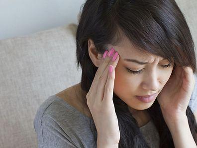 woman with headache, migraine, stress, insomnia, hangover, asian caucasian indoor scene