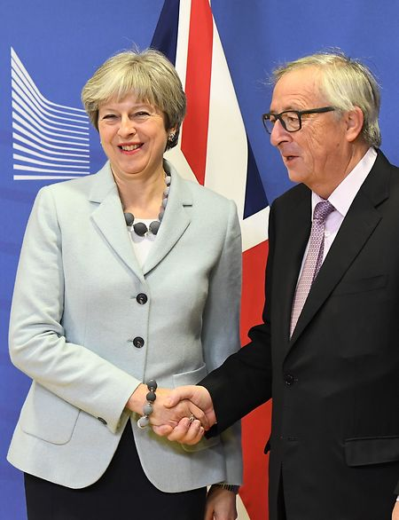 British Prime Minister Theresa May is welcomed by European Commission Jean-Claude Juncker at European Commission in Brussels on December 8, 2017. (Photo: AFP