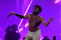 (FILES) In this file photo taken on September 21, 2018 Childish Gambino performs on stage during the iHeartRadio Music Festival at the T-Mobile arena in Las Vegas, Nevada. - Music's biggest stars will gather in Los Angeles on Sunday for the Grammy Awards, and this year observers are hoping the hip-hop and women artists leading the pack will get their due. The industry's annual gala draws eye rolls every year from critics who say the winners are too white and too male, but for the second consecutive year black hip-hop artists dominated the nominations across the board. (Photo by Valerie MACON / AFP)
