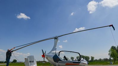 Pavel Brezina, owner of Nirvana Autogyro company, prepares his autogyro at the airport near Prerov city in the Czech Republic on May 17