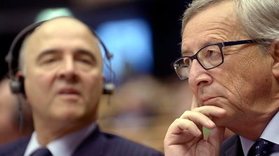 European Commission President, Luxembourg's Jean Claude Juncker and Pierre Moscovici, the European Commissioner for economics, taxation and customs, attend a session at the European Parliament in Brussels November 12, 2014.