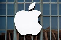 """(FILES) A file photo taken on September 7, 2016 shows the Apple logo on the outside of Bill Graham Civic Auditorium in San Francisco, California. - Apple on August 30, 2018 sent out invitations to a September 12 event at which it is expected to unveil new additions to its money-making iPhone line-up.In typical enigmatic style, Apple offered scant clues to what it has in store for the presentation to take place in the Steve Jobs Theater at its spaceship campus in the Silicon Valley city of Cupertino.Invitations had the words """"Gather round"""" under a large golden circle. (Photo by Josh Edelson / AFP)"""
