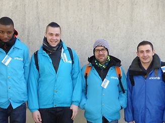 Genuine UNICEF working in their blue jackets with UNICEF logos clearly visible