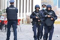 "Policemen patrol on November 3, 2020 close to a crime scene in Vienna after a shooting. - A huge manhunt was under way Tuesday, November 3, 2020 after gunmen opened fire on November 2, 2020 at multiple locations across central Vienna, killing at least four people in what Austrian Chancellor Sebastian Kurz described as a ""repulsive terror attack"". (Photo by HERBERT PFARRHOFER / APA / AFP) / Austria OUT"