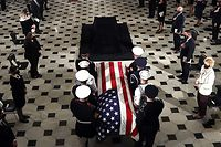 WASHINGTON, DC - SEPTEMBER 25: U.S. Supreme Court Associate Justice Ruth Bader Ginsburg's flag-draped casket is carried into Statuary Hall where she will lie in state at the U.S. Capitol on September 25, 2020 in Washington, DC. Ginsburg, who was appointed by former U.S. President Bill Clinton, served on the high court from 1993 until her death on September 18, 2020. She is the first woman to lie in state at the Capitol.   Chip Somodevilla/Getty Images/AFP == FOR NEWSPAPERS, INTERNET, TELCOS & TELEVISION USE ONLY ==
