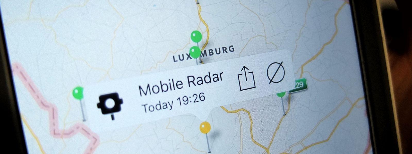 Die Apps für Smartphones warnen auf Knopfdruck andere Fahrer vor mobilen Radarfallen.