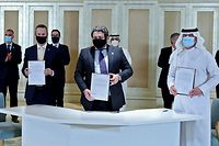 "TOPSHOT - A handout image provided by United Arab Emirates News Agency (WAM) shows Emirati and Israeli delegates signing an agreement at the first Abraham Accords Business Summit in Abu Dhabi on October 19, 2020 in the presence of US Treasury Secretary Steven Mnuchin (back-2nd L). - Israel and UAE signed a US-brokered deal to normalise ties at the White House on September 15, marking the first such deal with a Gulf nation. (Photo by - / WAM / AFP) / === RESTRICTED TO EDITORIAL USE - MANDATORY CREDIT ""AFP PHOTO / HO / WAM"" - NO MARKETING NO ADVERTISING CAMPAIGNS - DISTRIBUTED AS A SERVICE TO CLIENTS ==="