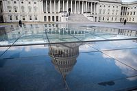 """The US Capitol is seen in Washington DC on December 24, 2018. - US lawmakers headed home for Christmas leaving the government partially shut for a third day in an impasse over President Donald Trump's demand for border wall funding. More than 400,000 federal employees are reporting to their jobs on Monday but won't get their salaries, while nearly 400,000 others """"will be locked out of work with no pay,"""" the American Federation of Government Employees union said. (Photo by Eric BARADAT / AFP)"""