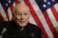(FILES) In this file photo taken on December 8, 2015 then Cardinal Theodore McCarrick, archbishop emeritus of Washington, speaks during a news conference with senators and national religious leaders to respond to attempts at vilifying refugees and to call on lawmakers to engage in policymaking and not 'fear-mongering' at the U.S. Capitol. - Pope Francis has defrocked the former US cardinal Theodore McCarrick over accusations he sexually abused minors some 50 years ago, a Vatican statement said on February 16, 2019. The pope's decision followed a sentence from the Congregation for the Doctrine of the Faith, the Vatican institution that defends Catholic dogma. (Photo by CHIP SOMODEVILLA / GETTY IMAGES NORTH AMERICA / AFP)