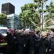 Members of the emergency services attend a minute's silence for the victims of the Grenfell Tower fire near the site of the blaze in North Kensington, London, Britain, June 19, 2017. REUTERS/Marko Djurica