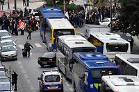 Members of the General Confederation of Labour (CGT), a French trade union and demonstrators block the buses leaving from the bus station by the Saint Charles university ahead of a march to protest against the pension overhauls, in Marseille, southern France, on December 5, 2019 as part of a national general strike. - Trains cancelled, schools closed: France scrambled to make contingency plans on for a huge strike against pension overhauls that poses one of the biggest challenges yet to French President's sweeping reform drive. (Photo by Clement MAHOUDEAU / AFP)