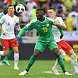 Senegal's forward Mbaye Niang (C) vies with Poland's midfielder Piotr Zielinski during the Russia 2018 World Cup Group H football match between Poland and Senegal at the Spartak Stadium in Moscow on June 19, 2018. / AFP PHOTO / Francisco LEONG / RESTRICTED TO EDITORIAL USE - NO MOBILE PUSH ALERTS/DOWNLOADS