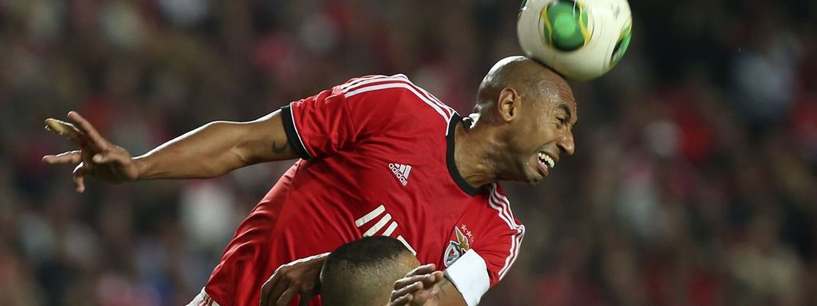 Benfica's player Luisao (R) fights for the ball with Slimani of Sporting's Lisbon during their derby 4th leg soccer match of the Portugal's Cup, at Luz stadium in Lisbon, Portugal, 9th November 2013. MANUEL DE ALMEIDA/LUSA