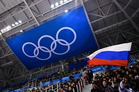 "(FILES) In this file photograph taken on February 16, 2018, a spectator waves the Russian flag during the men's preliminary round ice hockey match between the Olympic Athletes from Russia and Slovenia during the Pyeongchang 2018 Winter Olympic Games at the Gangneung Hockey Centre in Gangneung. - In Russia, where criticism of the authorities can lead to dire consequences, the head of the country's anti-doping agency Yury Ganus has openly accused officials of tampering with data handed to the global watchdog. ""It's dangerous but it's my mission,"" the head of RUSADA told AFP, asked if he felt afraid after assigning blame to the sports ministry and Russian law enforcement. The executive of the World Anti-Doping Agency (WADA) is to meet in Lausanne, Switzerland on December 9, 2019, to decide on a proposed four-year international ban of Russian athletes over the handling of doping allegations. (Photo by Brendan Smialowski / AFP)"