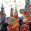 (From L to R) Russian presidential aide Igor Levitin, goalkeeper of the Russian national soccer team Igor Akinfeev, sports minister Vitaly Mutko, First Deputy Prime Minister Igor Shuvalov and Moscow's Mayor Sergei Sobyanin take part in a ceremony to launch the clock, counting down the days to the beginning of the 2018 FIFA World Cup, during the celebrations marking the 1,000 remaining days in Manezhnaya Square in central Moscow, Russia, September 18, 2015. REUTERS/Maxim Zmeyev